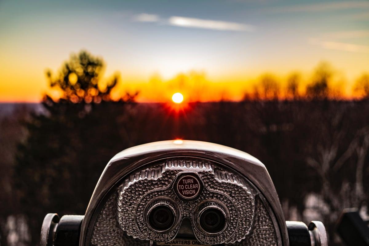 sunset view of nature with binoculars