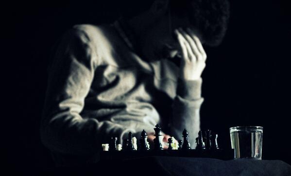 man playing chess and thinking