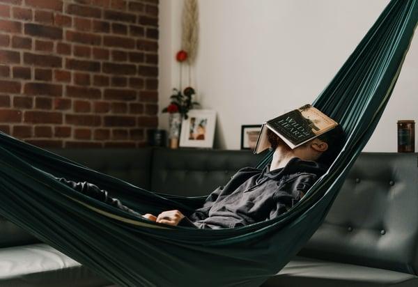 man sleeping in a hammock